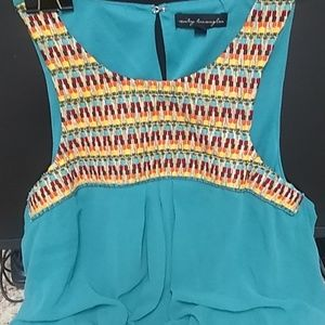 Full length teal dress with embroidery details